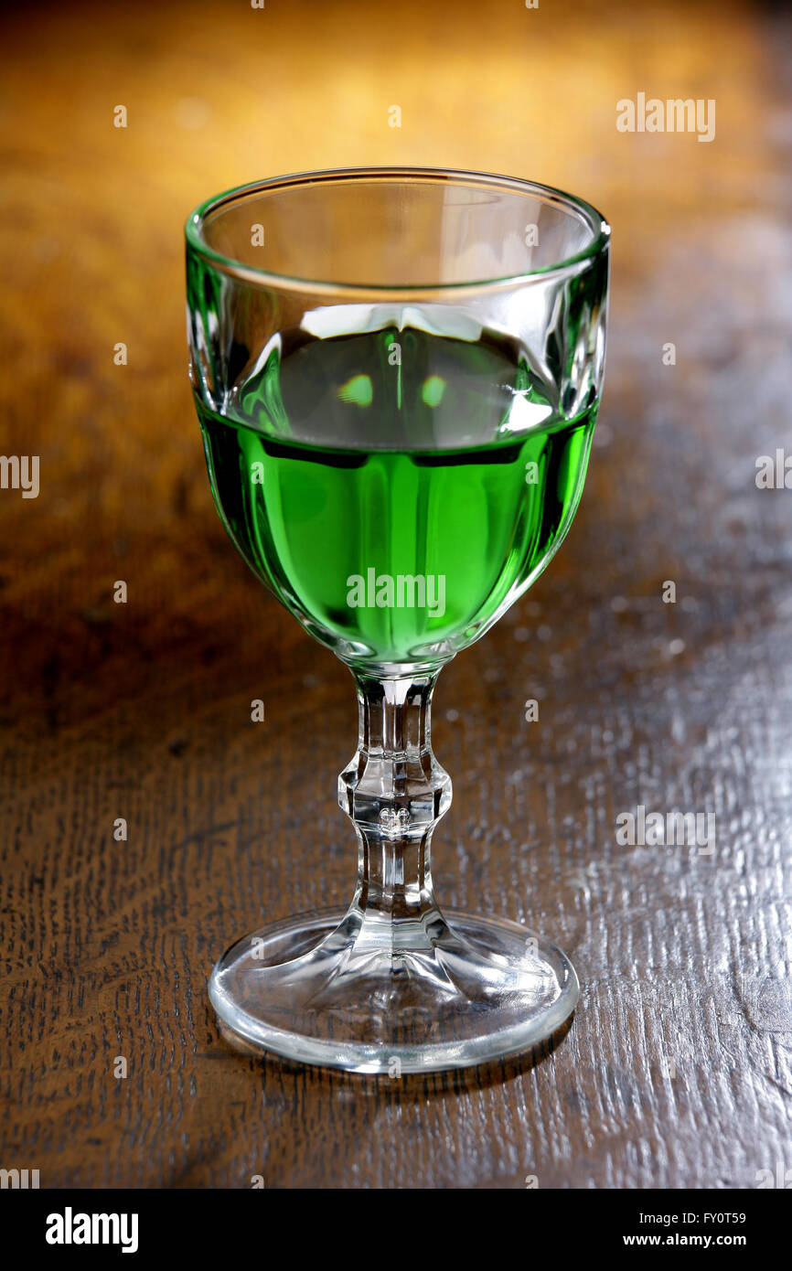 Glass of Absinthe on a bar top - Stock Image