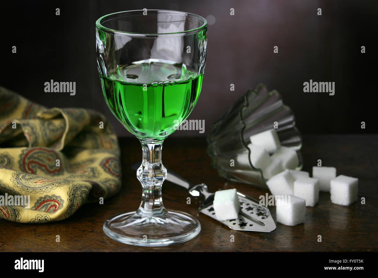 Glass of Absinthe with Absinthe Spoon and sugar. - Stock Image
