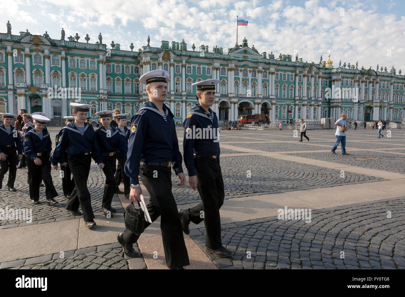 Boys clothing sailors walking on the Palace Square at the center of St. Petersburg city, Russia - Stock Image