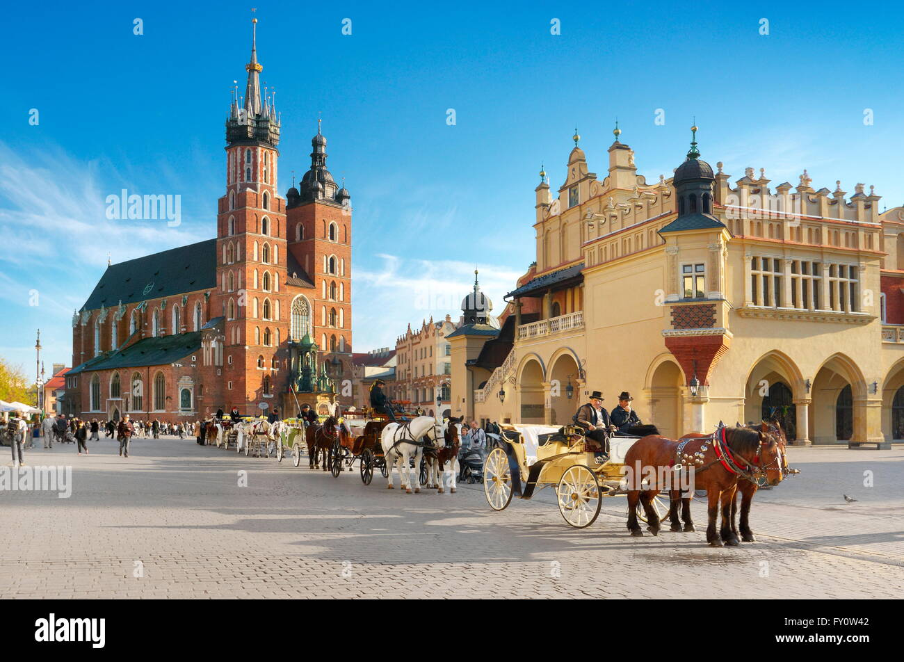 Horse carriage waiting for tourists, Market Square, Cracow Old Town, Poland - Stock Image
