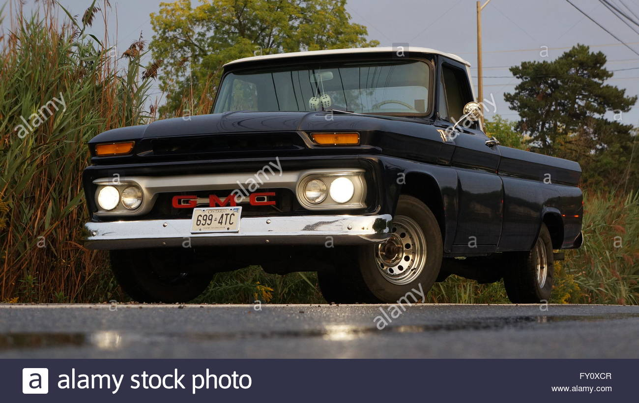 Blue 1966 Gmc Pickup Truck In The Country With The Lights On Stock Photo Alamy