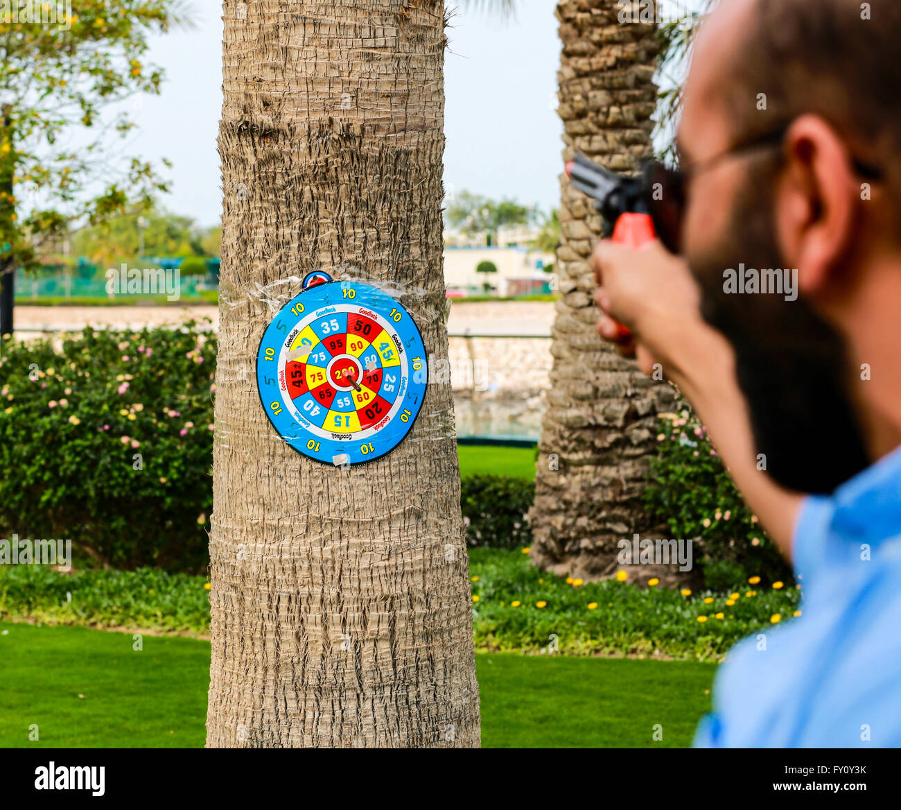 Aim is achieved! Men shoots to the target. - Stock Image
