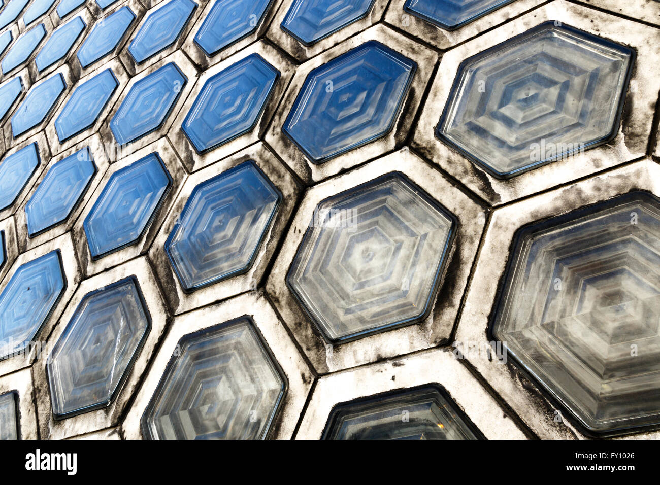 Pattern of grimy hexagonal glass brick - Stock Image