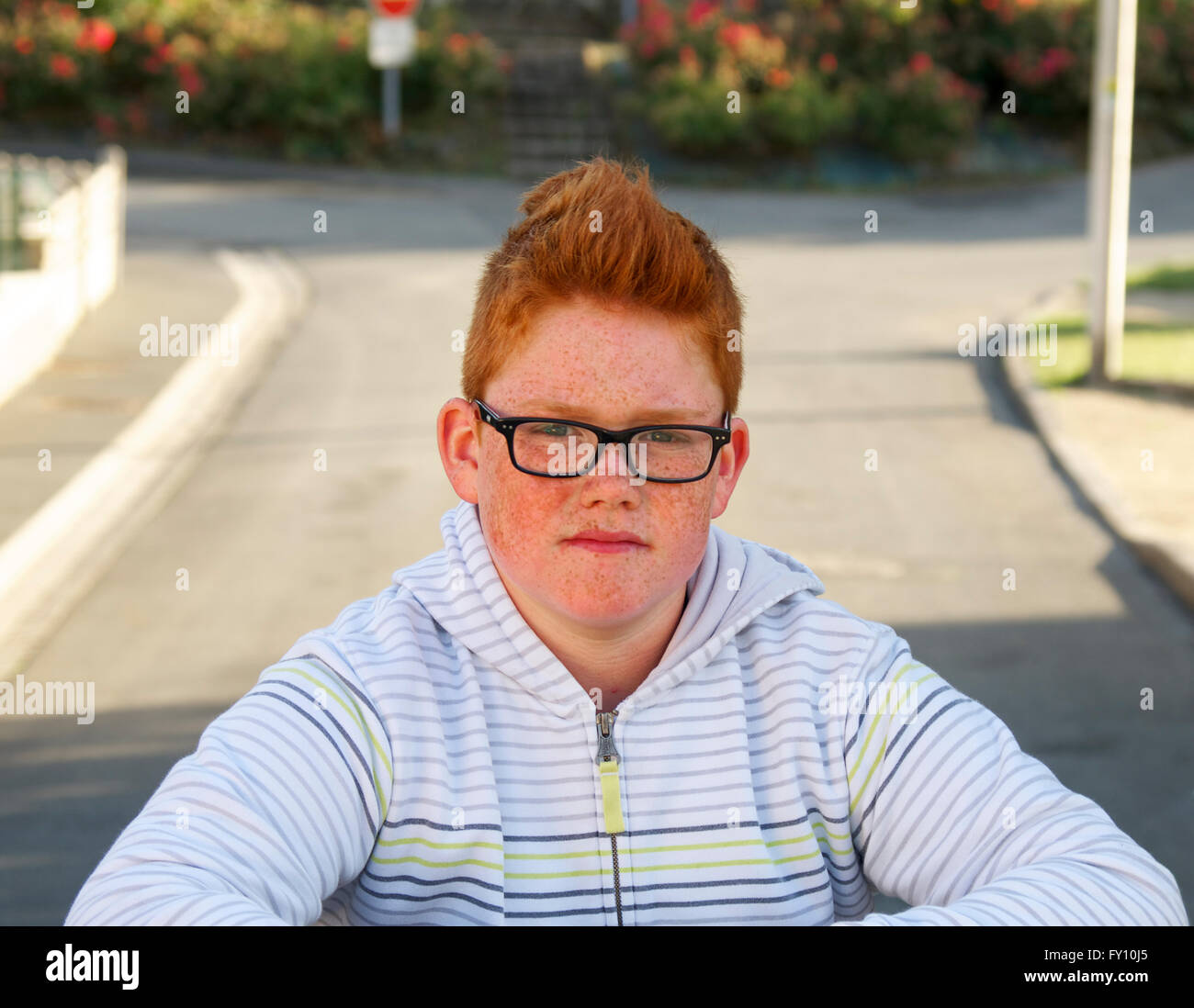 A ginger haired Breton boy with glasses - Stock Image