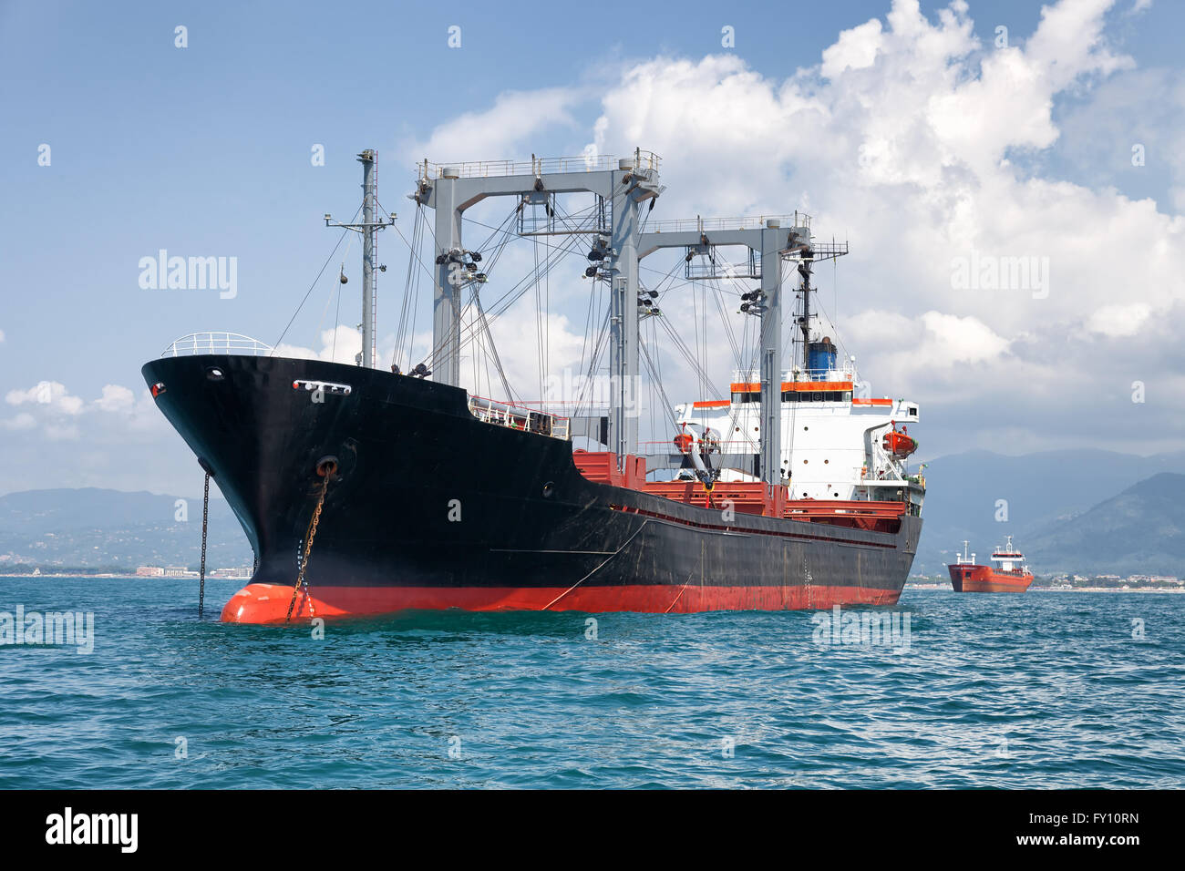 commercial cargo ship on ocean - Stock Image