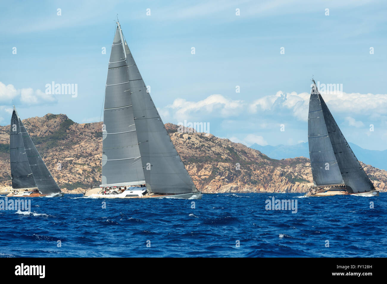 group yacht sailing in regatta - Stock Image