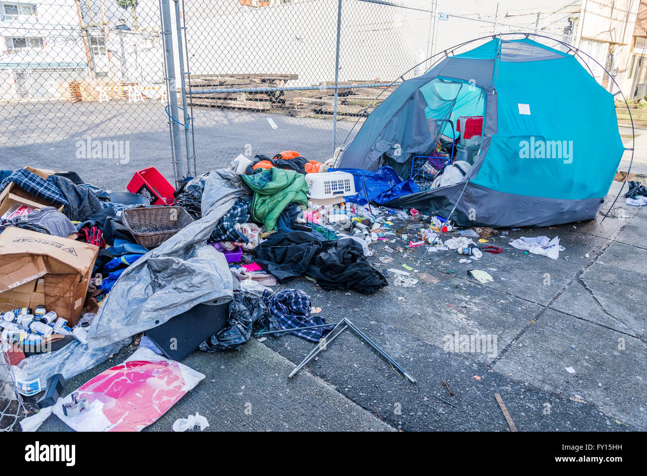 Messy garbage around and in homeless persons tent. DTES, Vancouver, British Columbia, Canada - Stock Image