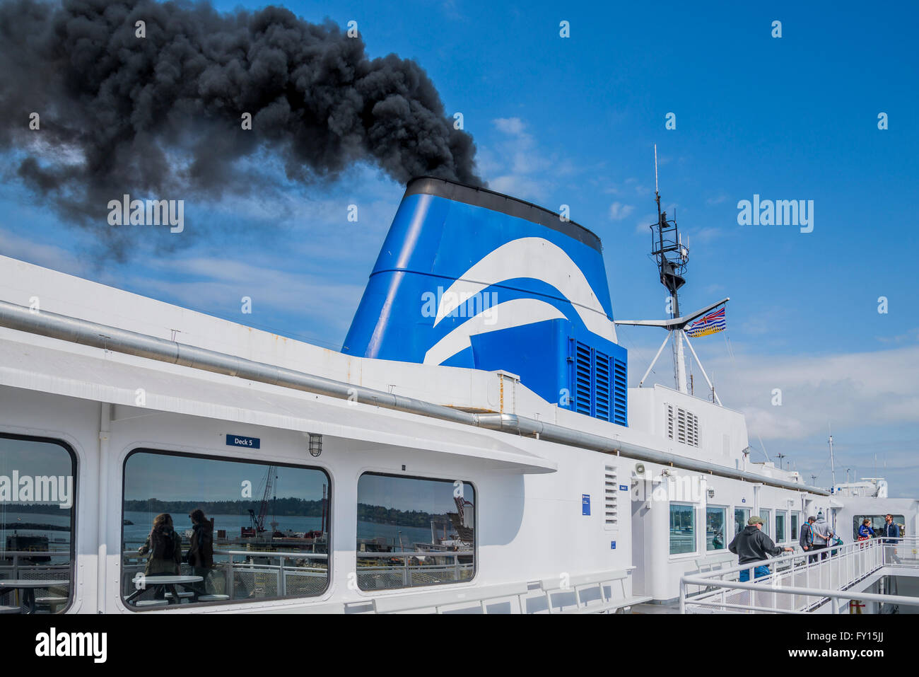 Black smoke from ship's funnel  BC Ferry - Stock Image