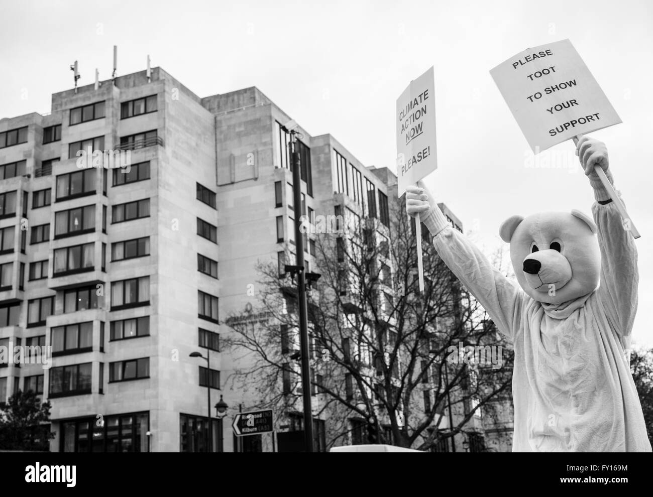 Protester dressed up like a polar bear to support the campaign against climate change. Shot during the Climate March Stock Photo