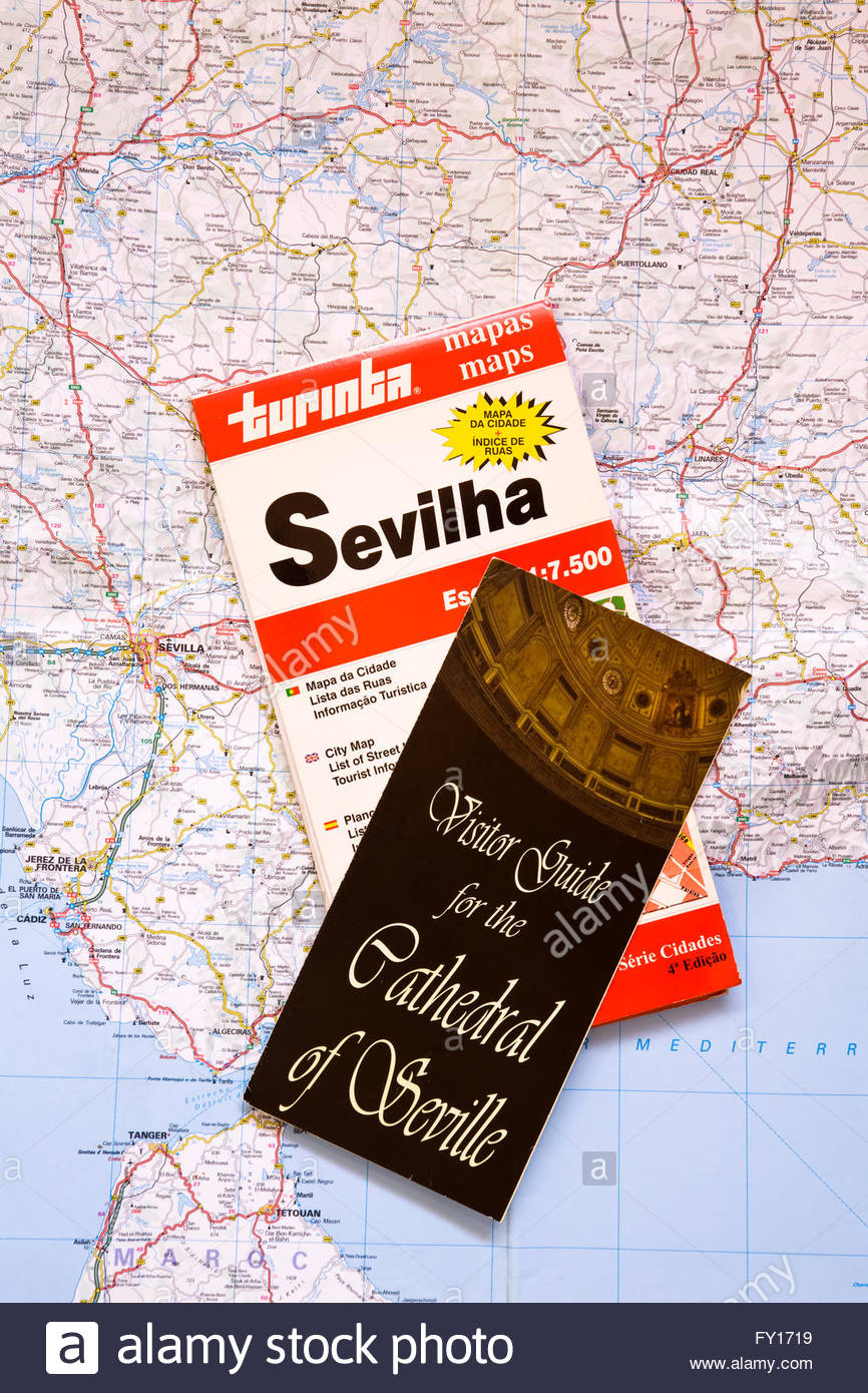 Travel Map Of Spain.Travel Brochures For Seville And Map Of Spain Stock Photo 102675029