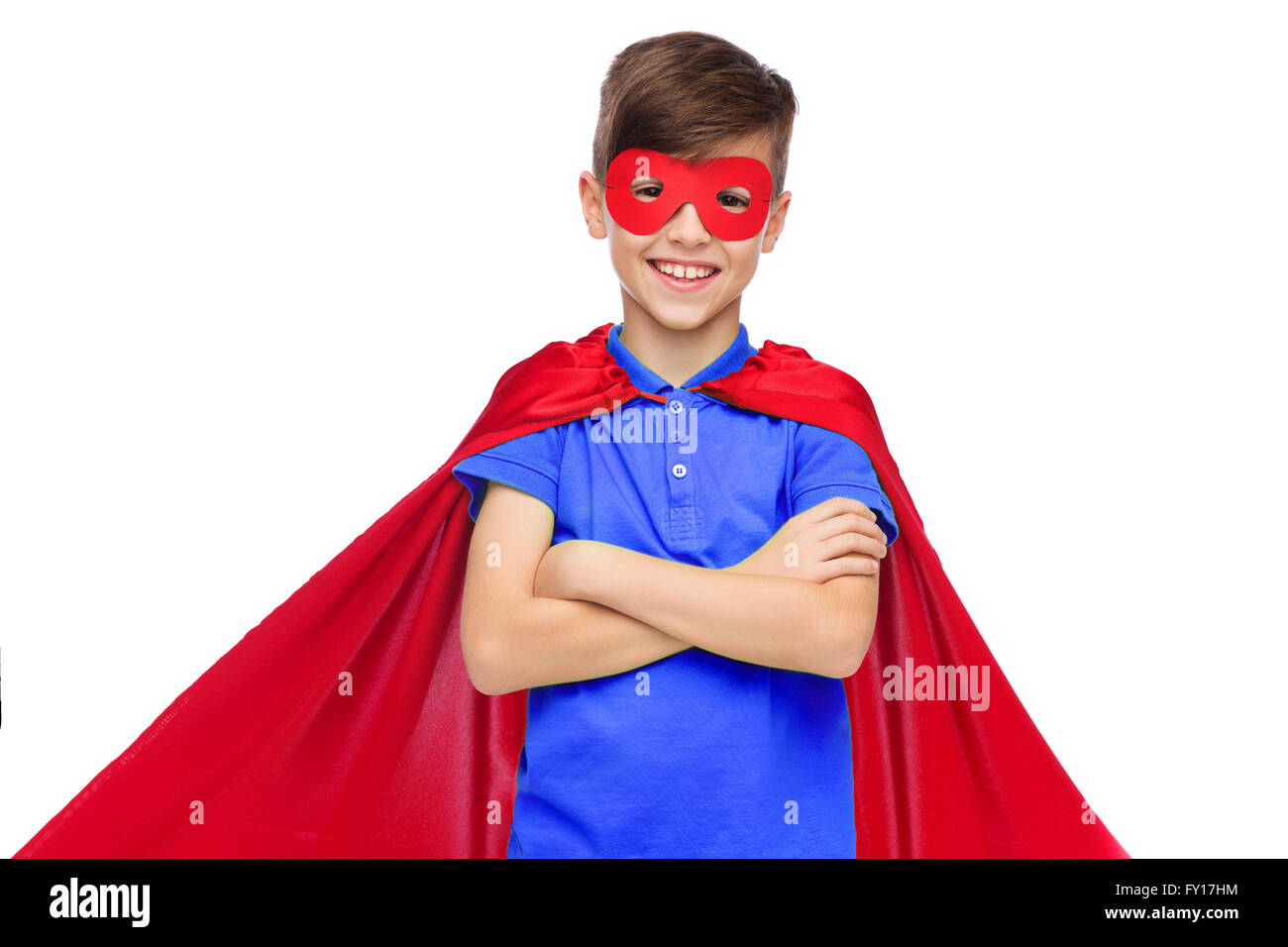 boy in red super hero cape and mask - Stock Image