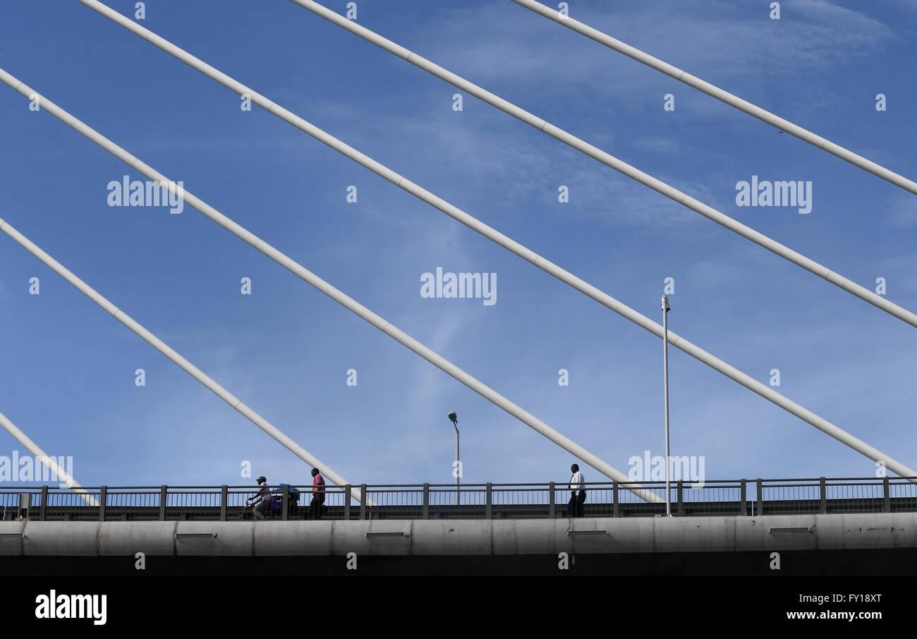 (160419) -- DAR ES SALAAM, April 19, 2016 (Xinhua) -- Pedestrians walk on Kigamboni Bridge in Dar es Salaam, Tanzania, - Stock Image
