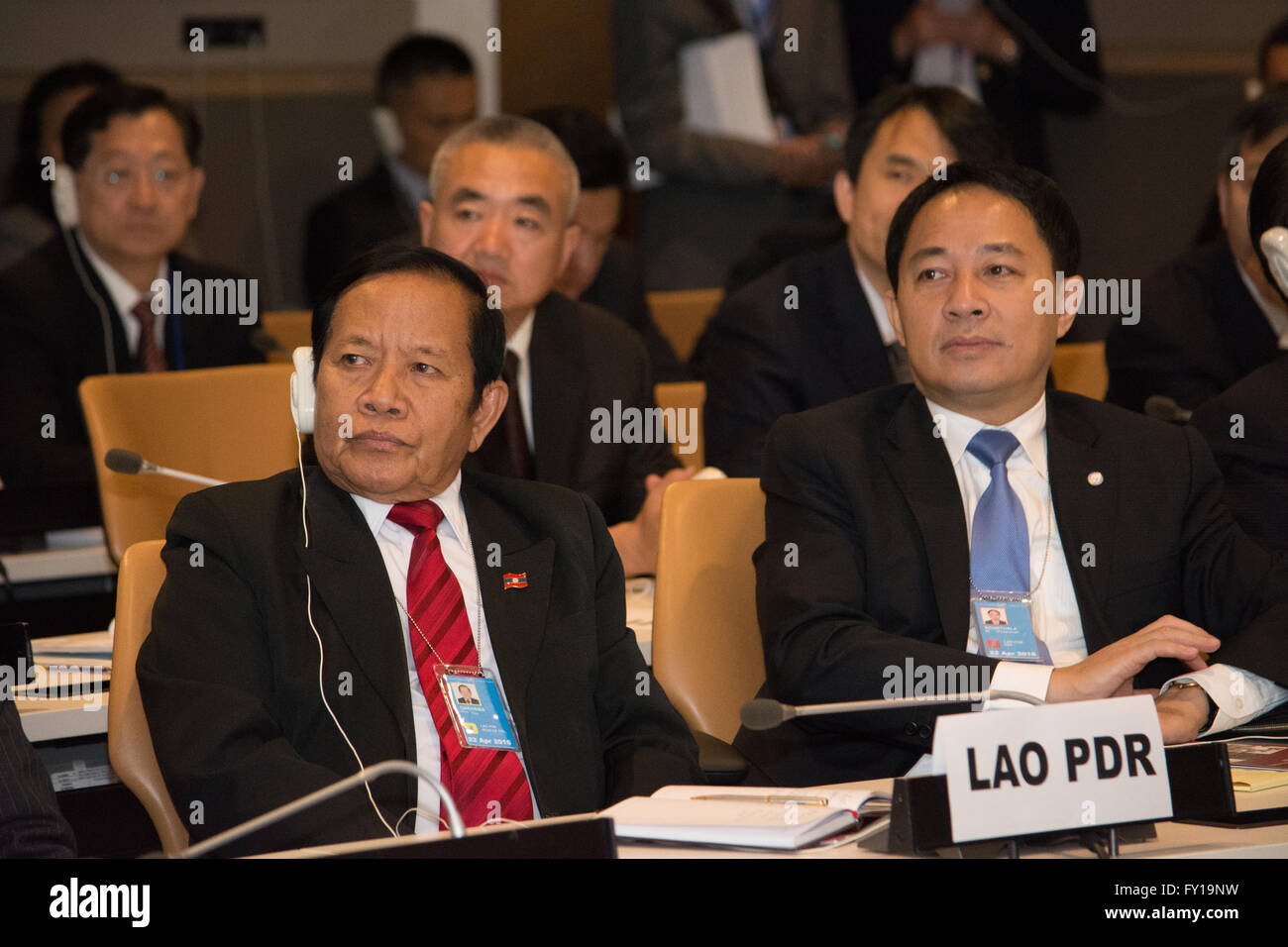 New York, USA. 19th April 2016.  Members of the Laotian delegation watch the UN Office on Drugs and Crime presentation - Stock Image