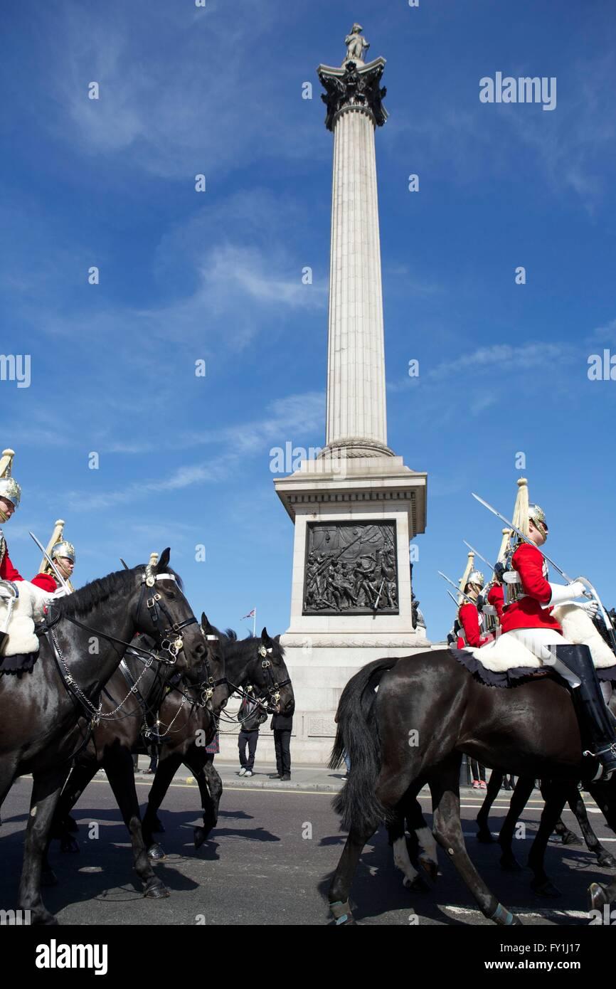 London, United Kingdom. 20 April 2016. The Household Cavalry pass through Trafalgar Square whilst exercising their Stock Photo