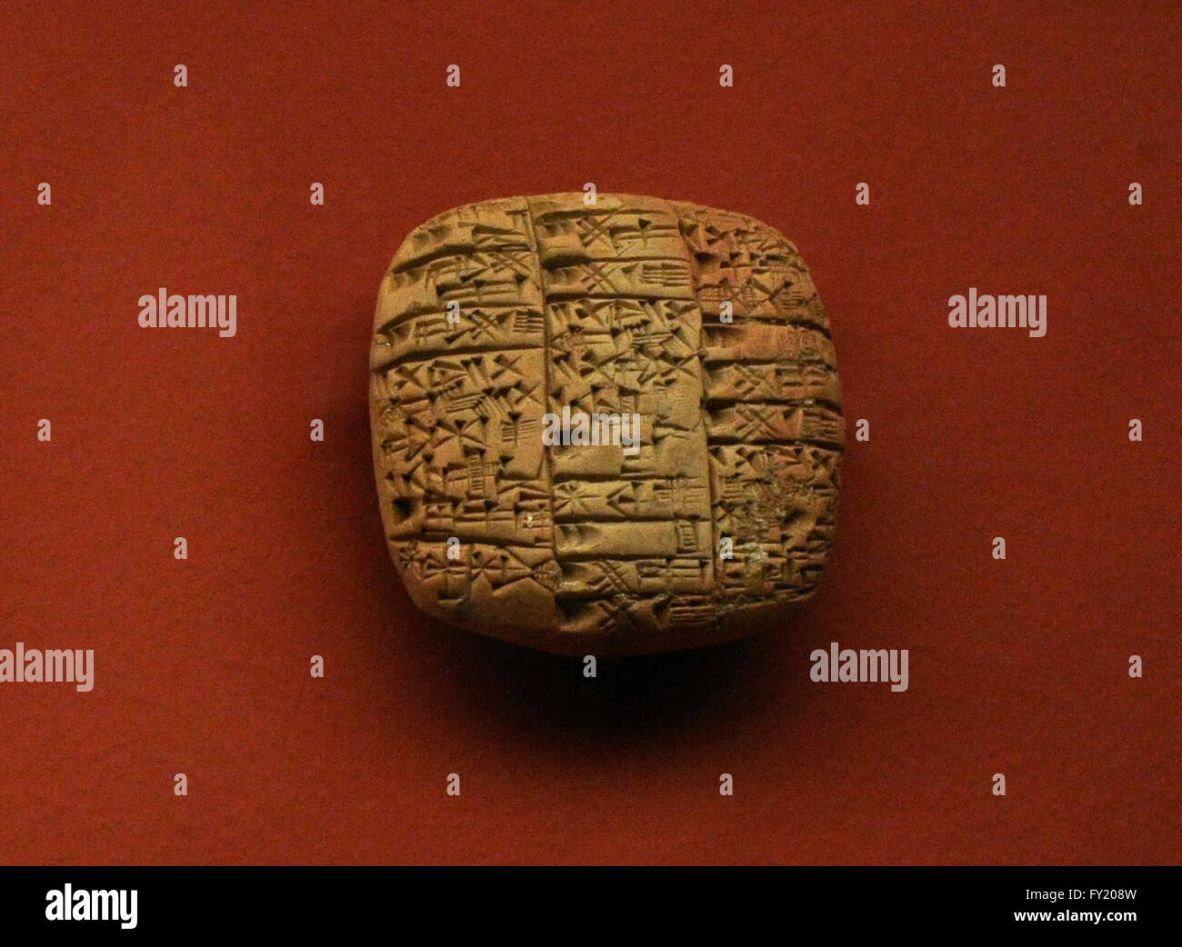 Sumer. Mesopotamia. Near East. Clay tablet. Offerings of flour, beer, butter, fish and cattle to the god Ningirsu and the Goddess Bau, his wife, as well as to other sanctuaries on the festival of the goddess Bau. The State Hermitage Museum. Saint Petersburg. Russia. Stock Photo
