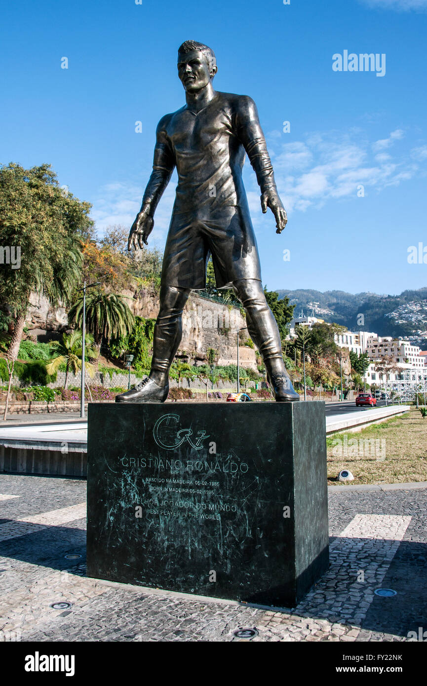 Statue of footballer Cristiano Ronaldo, CR7, Real Madrid, in the harbour of his native city, Funchal, Madeira, Portugal - Stock Image