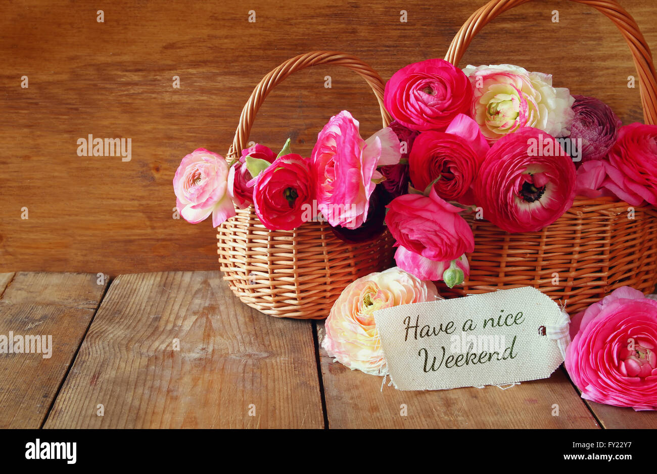 pink flowers in the basket next to card with phrase have