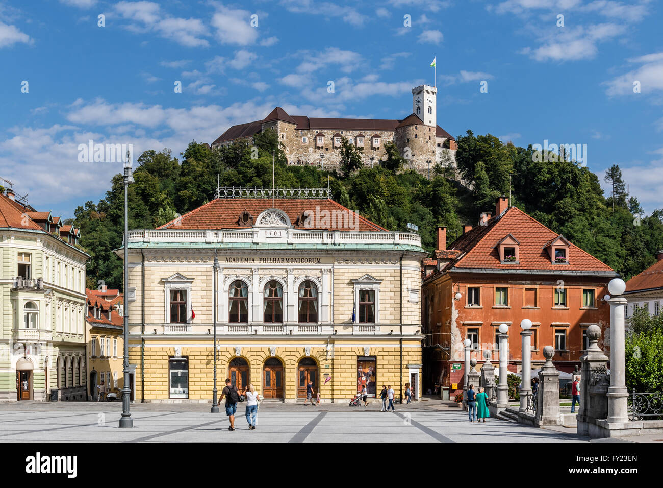 The Slovenian Philharmonic Hall and Ljubljana Castle - Ljubljana, Slovenia - Stock Image