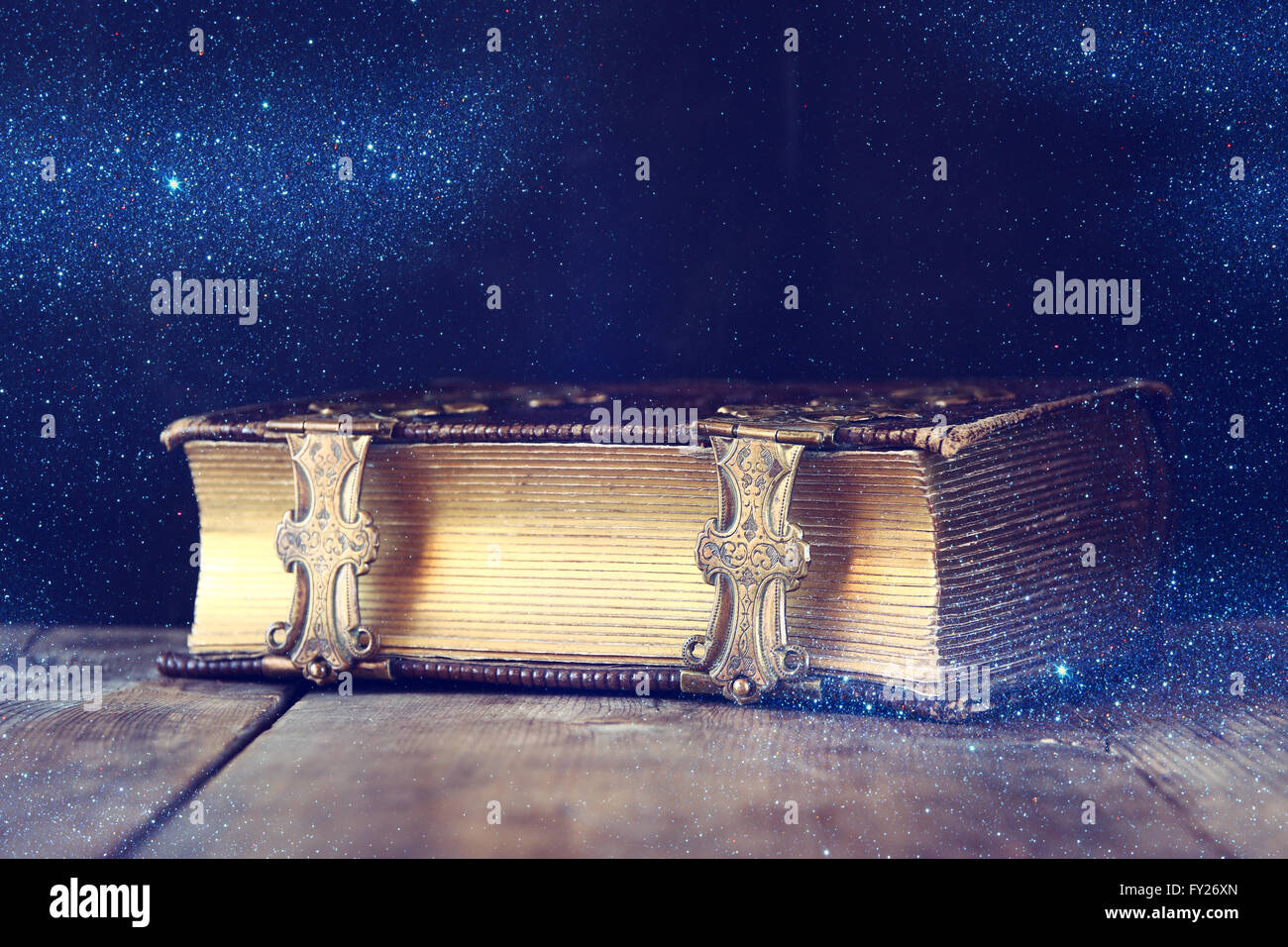 low key image of antique story book. vintage filtered with glitter overlay. selective focus - Stock Image