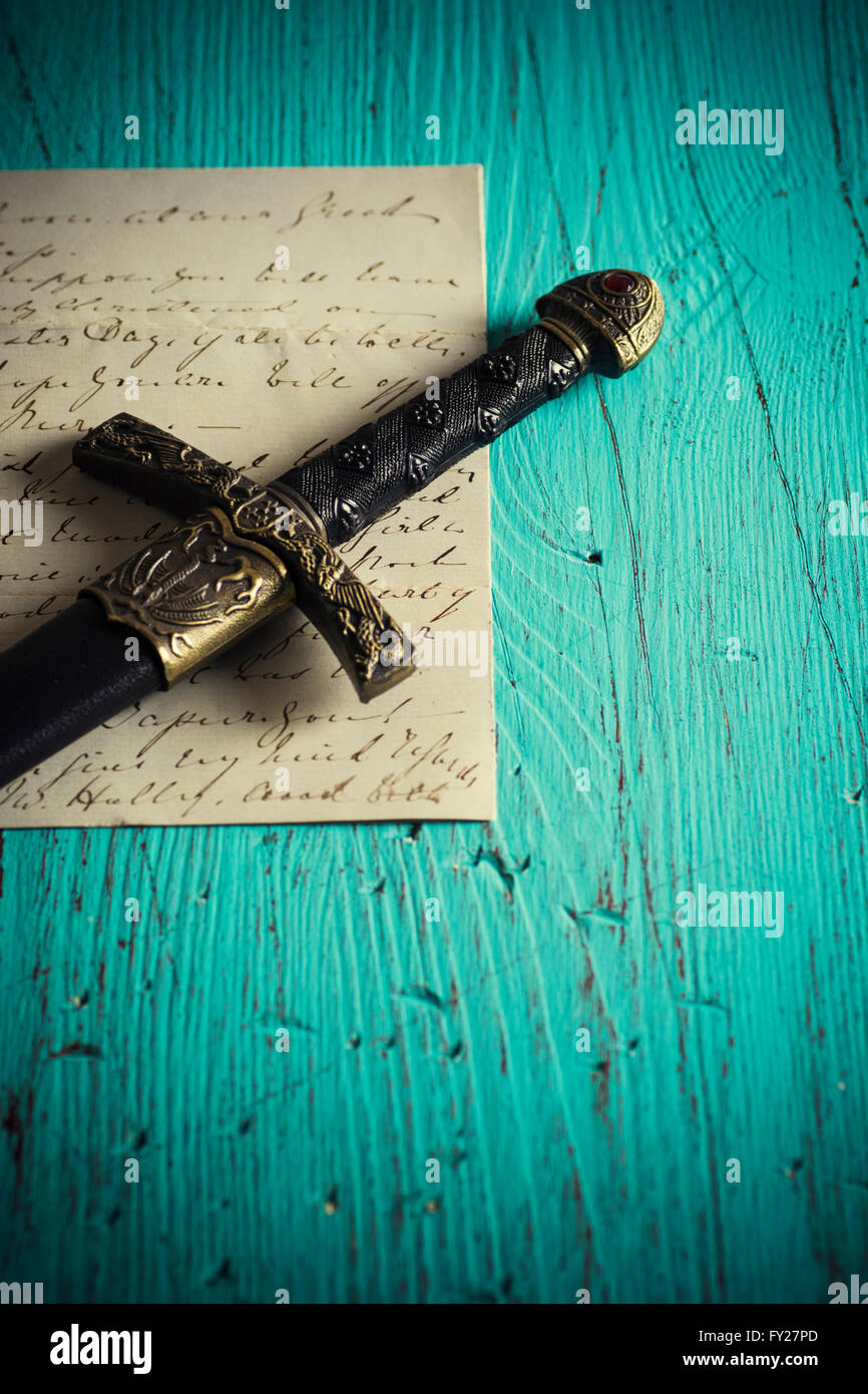 Historic dagger with an old letter - Stock Image