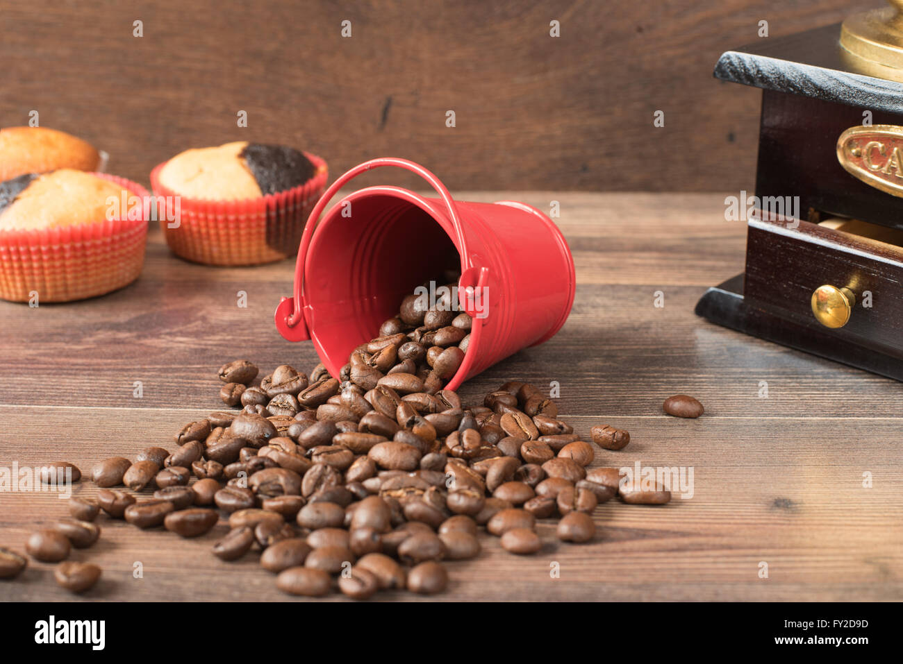 Retro coffee grinder, coffee mill coffee cup, chocolate cupcake, muffins, coffee beans. Still, restaurant, coffee - Stock Image