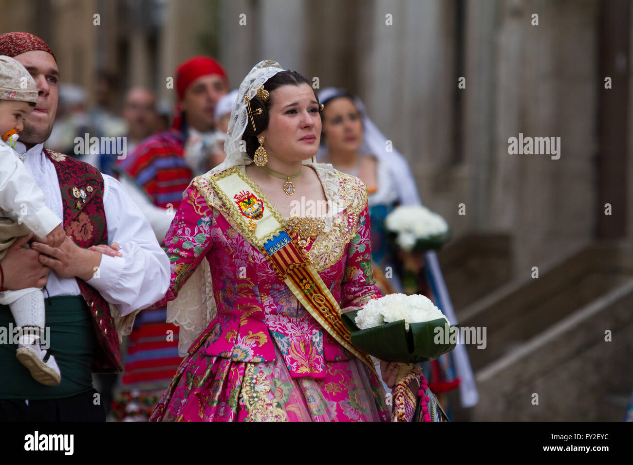 Flowering offering procession for the lady of the Forsaken during Fallas Festival  Valencia Spain - Stock Image