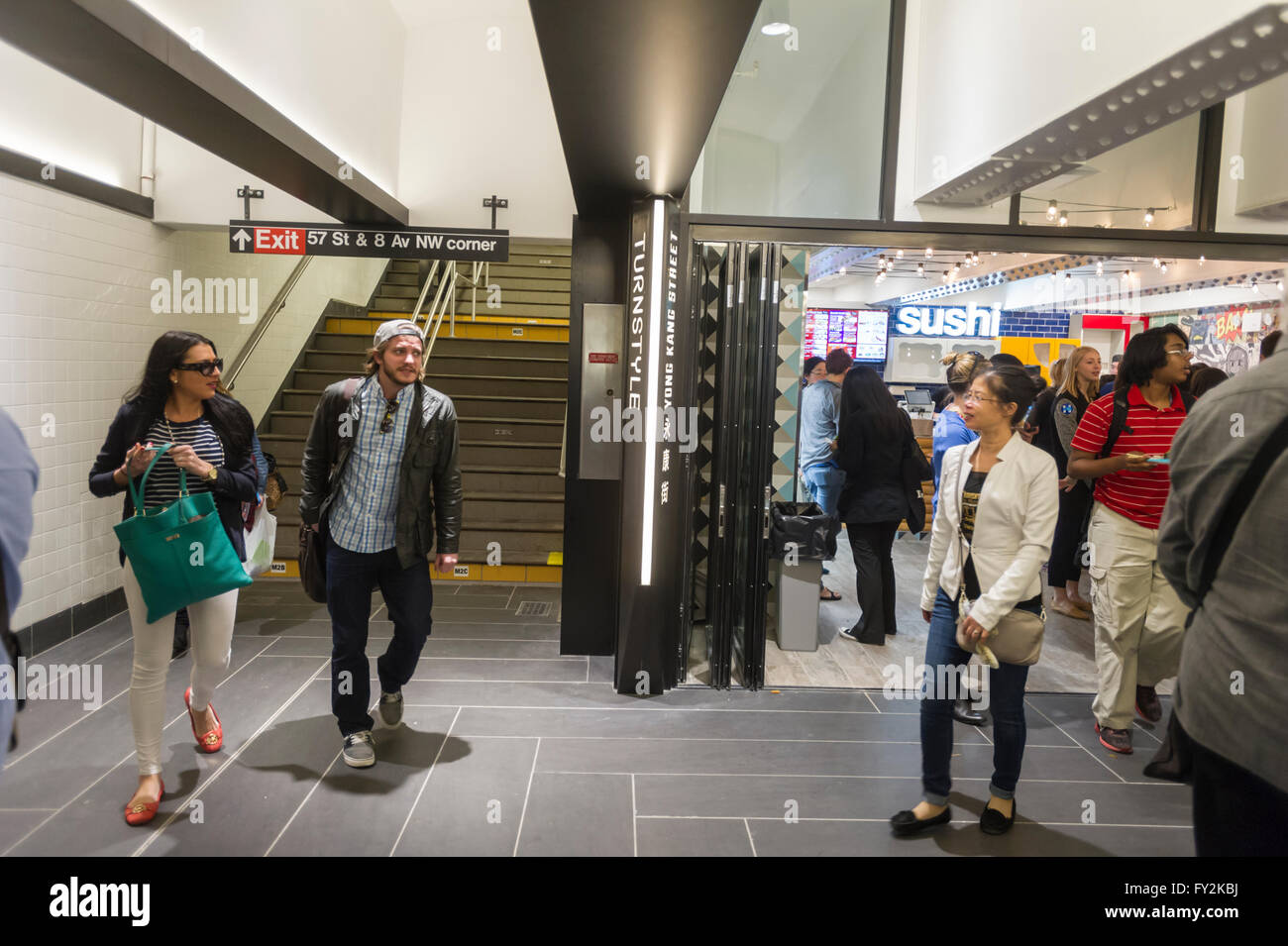 Visitors to the Columbus Circle station in the subway in New York try out the new Turnstyle food hall and retail Stock Photo