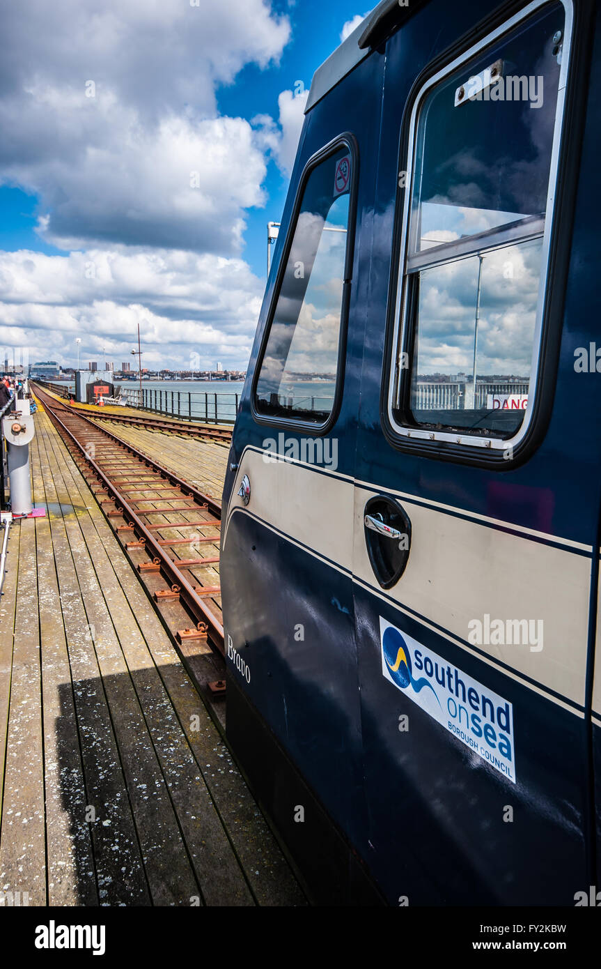 Train on Southend Pier, a major landmark in Southend. Extending 1.34 miles (2.16 km) into the Thames Estuary, it - Stock Image