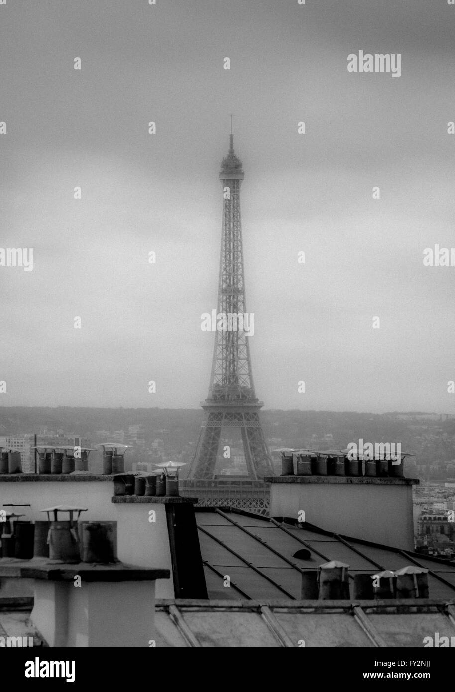 Chimney pots and rooftops with Eiffel Tower in background, Paris France. - Stock Image