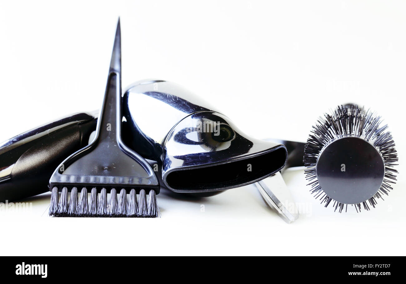 Tools for hairdresser (hair dryers, scissors, combs) - Stock Image