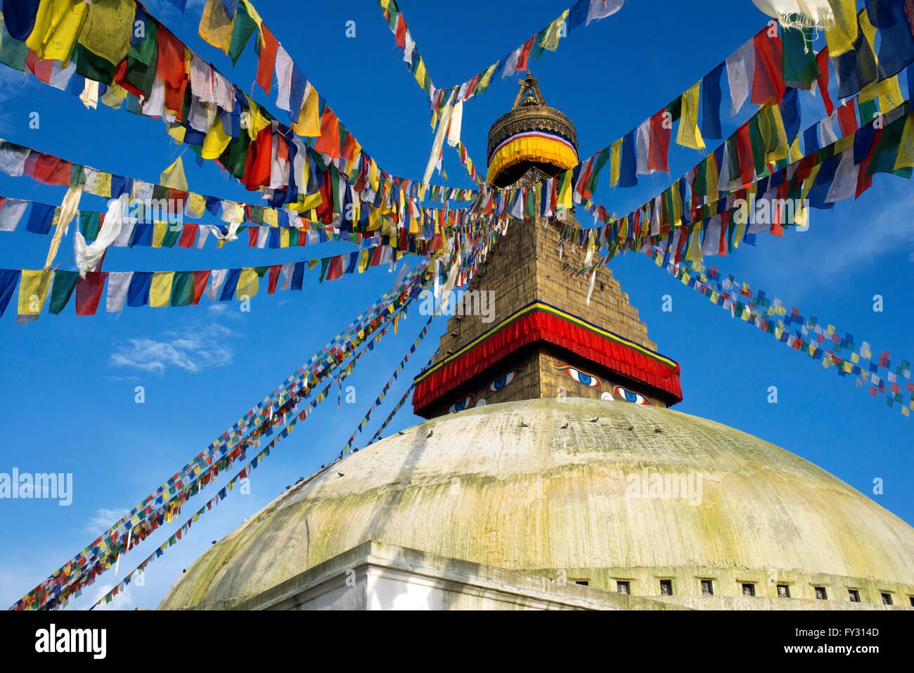 Tibetan flags and Bodhnath Buddhist Stupa, Kathmandu, Nepal, Asia - Stock Image