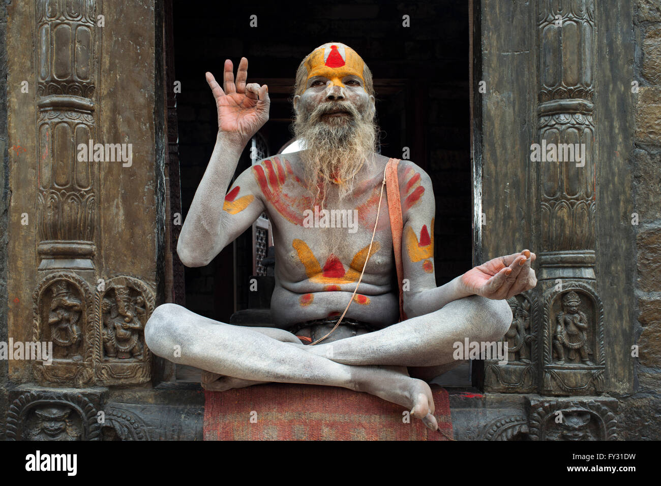 Portrait of a sadhu in Pashupatinath, Nepal. The place of the cremations by the Bagmati River. Holy man sadhu colourfully - Stock Image