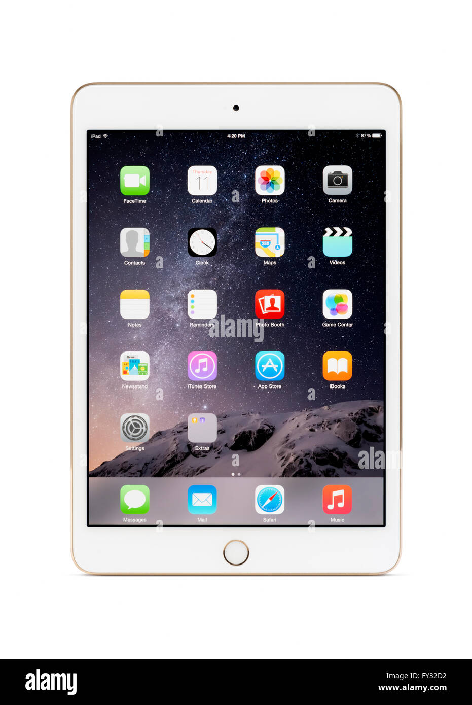 white gold apple ipad mini 3 tablet computer with desktop icons on