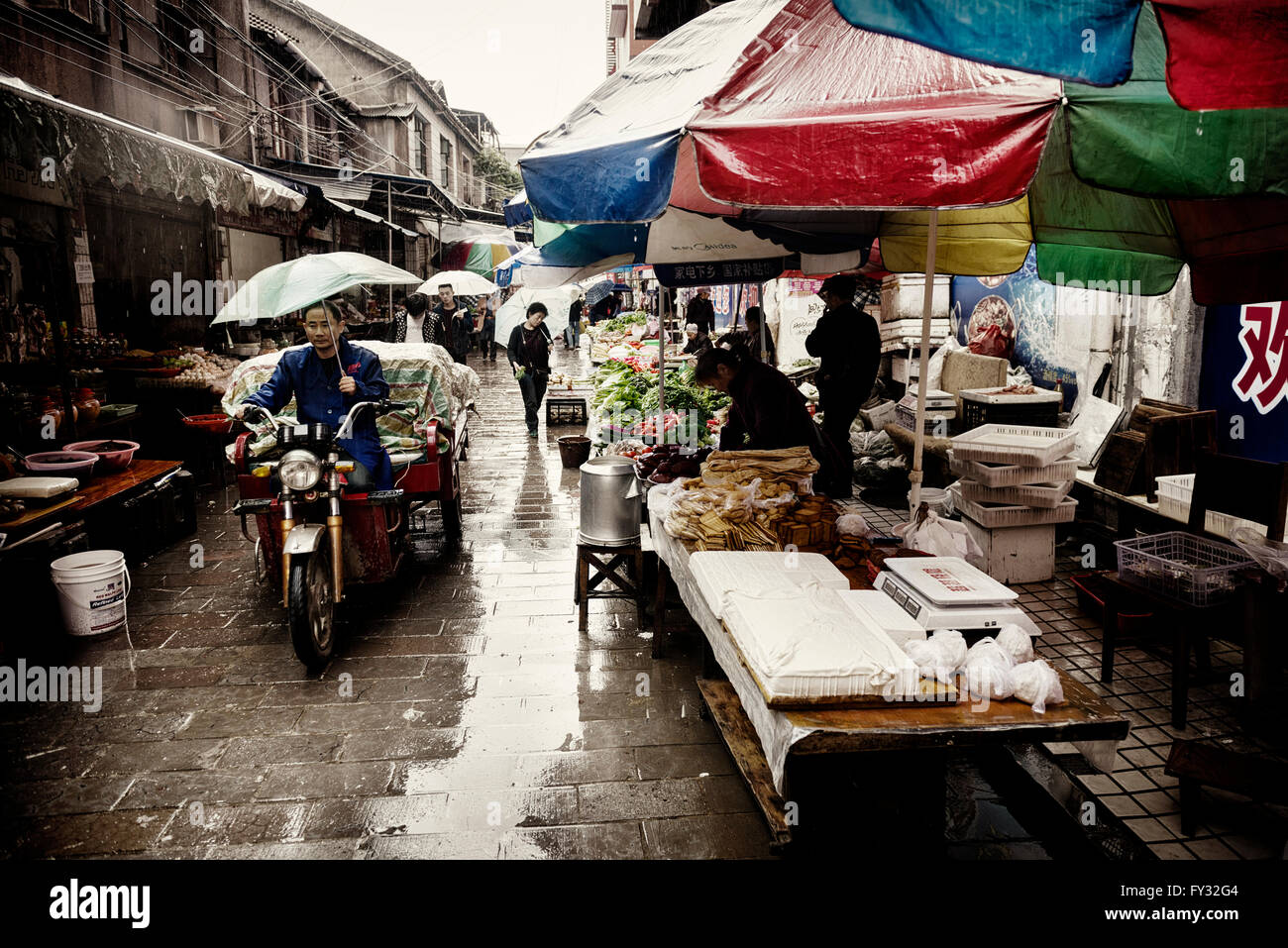 Street food market during rain, Zhangjiajie, Hunan, China - Stock Image