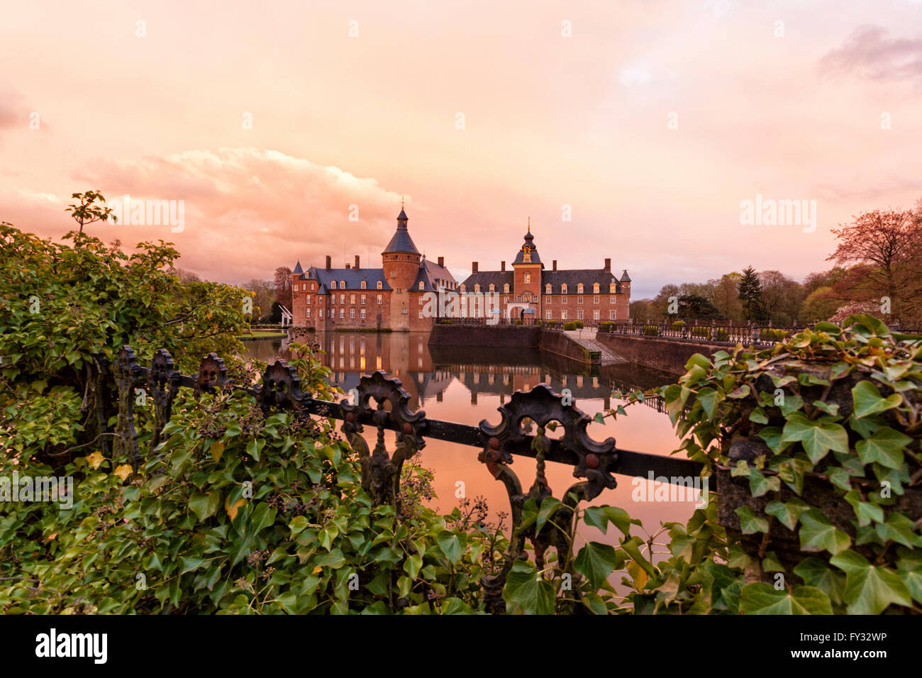 Castle Anholt at Isselburg in the Lower Rhine region at sunset - Stock Image