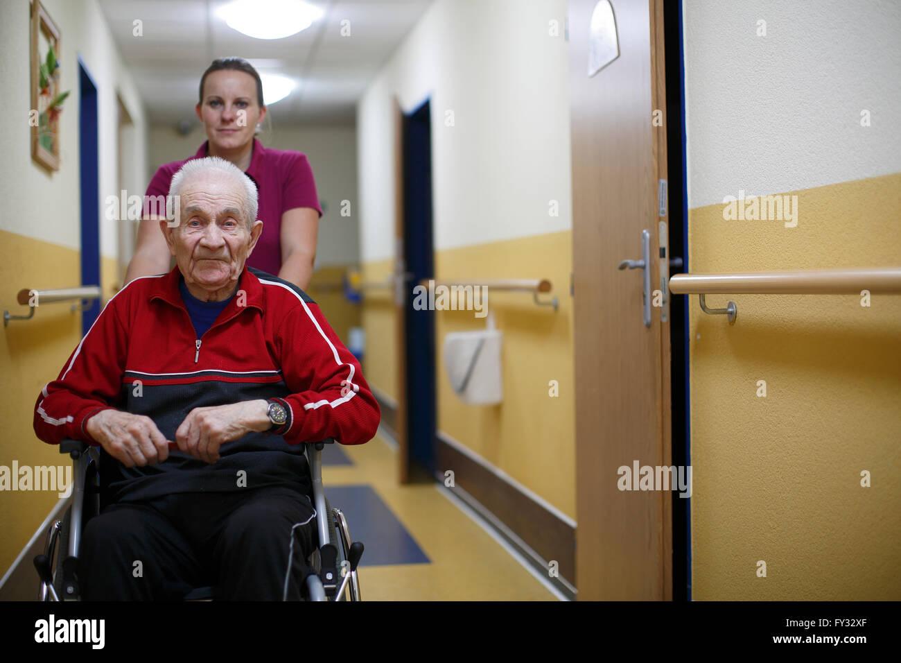 Senior citizen, 87 years, wheelchair, nurse for the elderly, nursing home - Stock Image