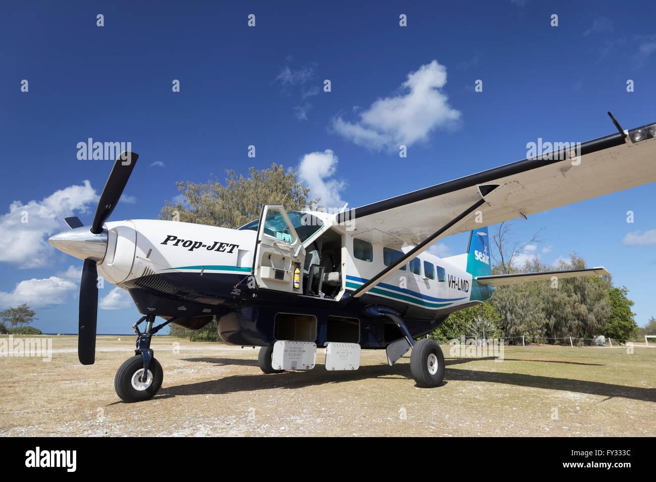 Cessna Caravan 208 Sea Air on unpaved airfield with open underfloor luggage lockers, Lady Elliot Island, Queensland, - Stock Image