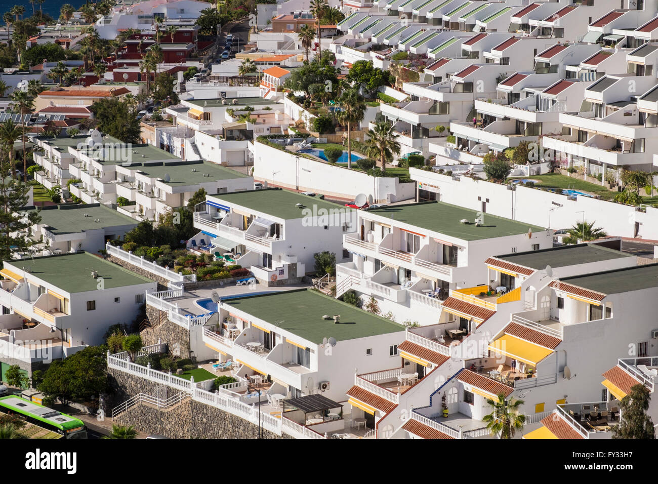 holiday homes and apartments on the hillside in los gigantes stock