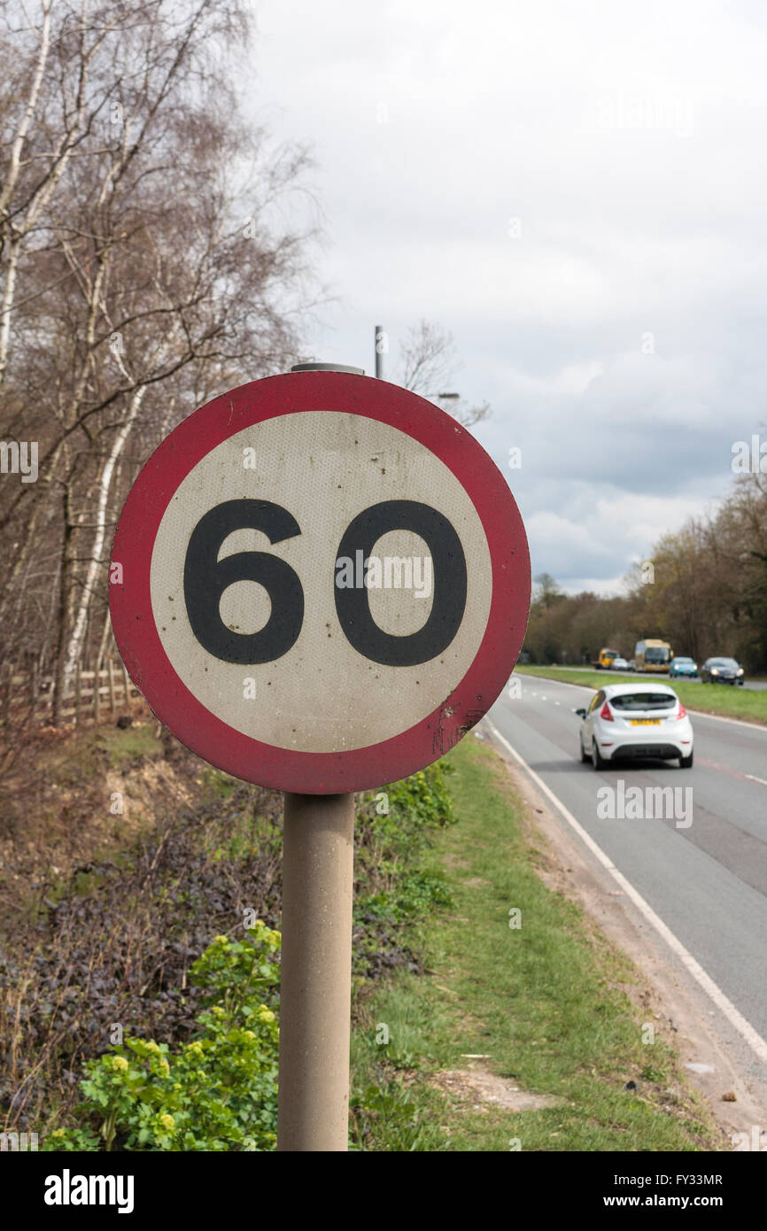 Speed limit sign on a dual-carriageway road indicating a speed limit of 60 mph (96 km/h) - Stock Image