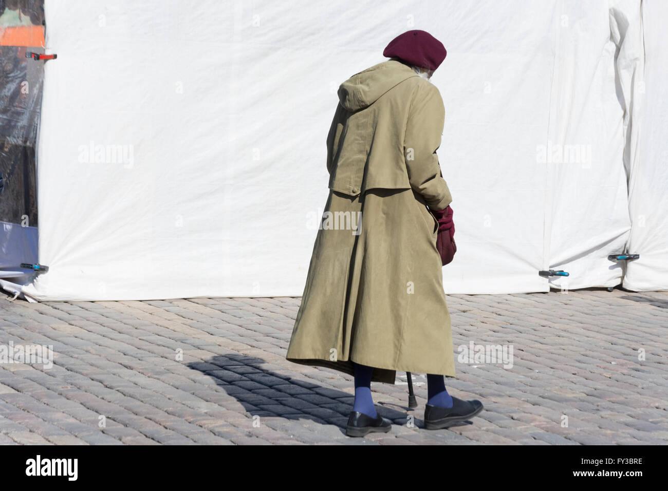 Old Woman at Kamppi in Helsinki Finland - Stock Image