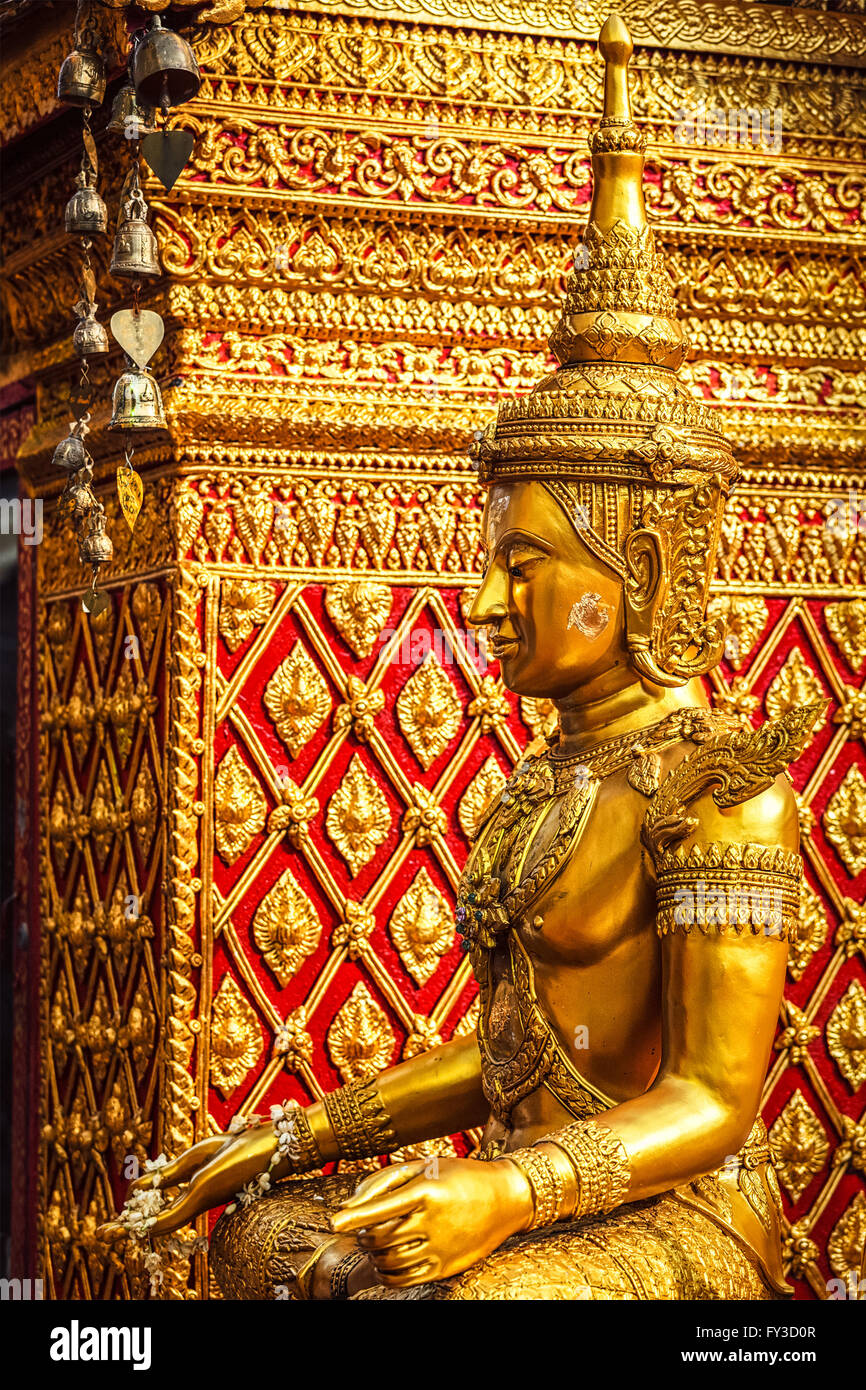 Gold sitting Buddha statue in Thailand - Stock Image
