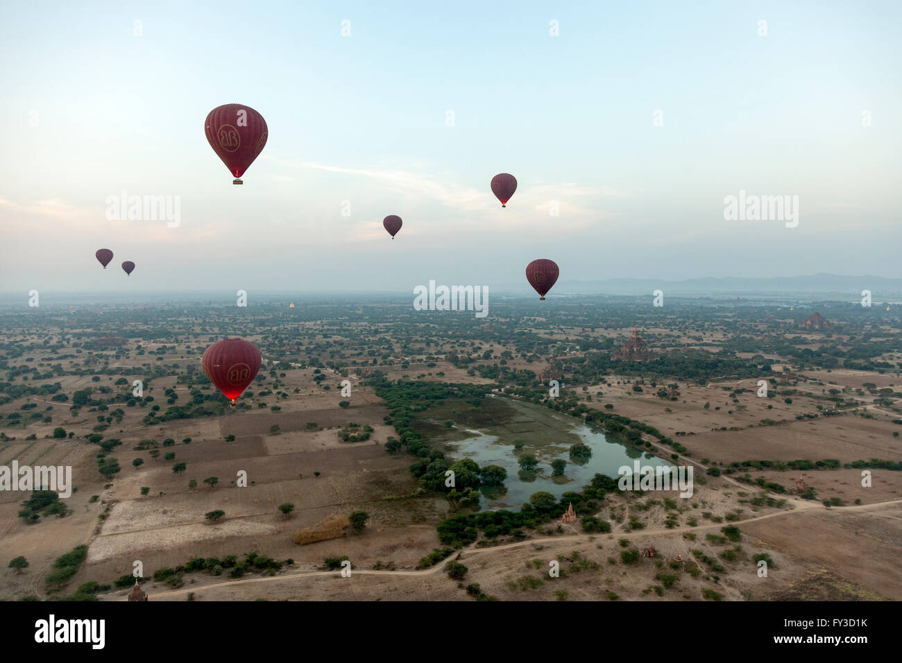 A fleet of hot air balloons in the sky of Bagan (Myanmar) Over there tourists can get the experience of their lifetime. - Stock Image