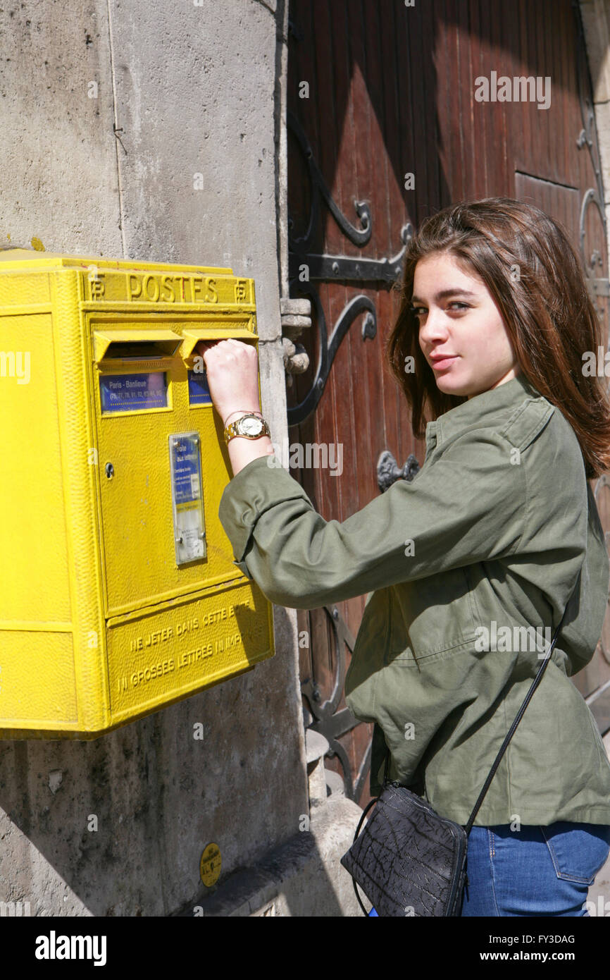 Young girl, teenager posting letters. - Stock Image