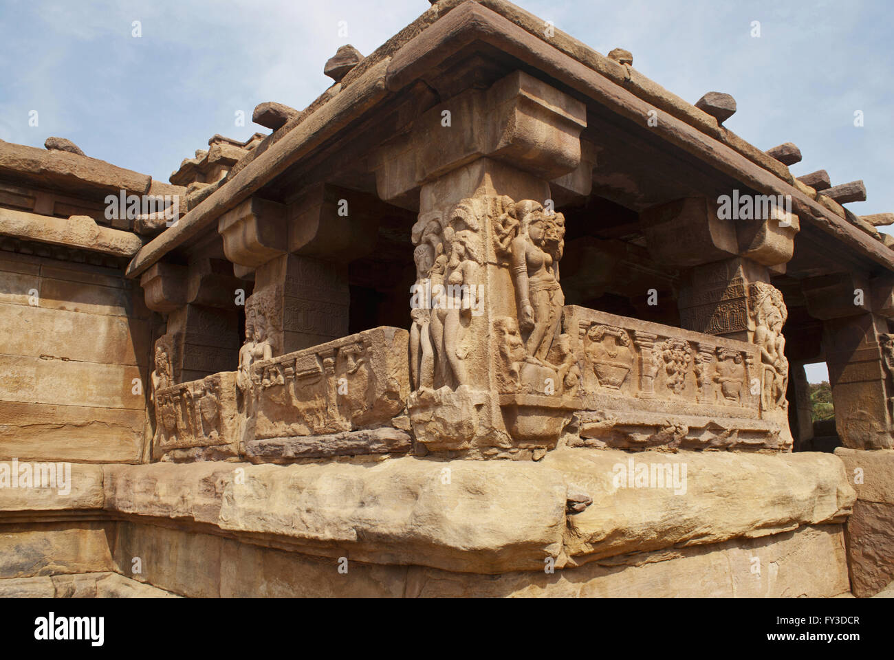 Carved figures and floral patterns on the decorated sober and square pillars of the sabha-mandapa of Lad Khan temple, - Stock Image