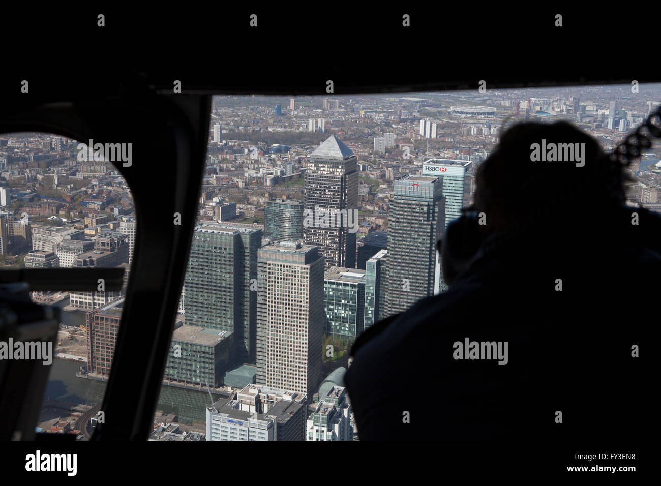 View from inside of Helicopter with door open over London during aerial photography trip - Stock Image