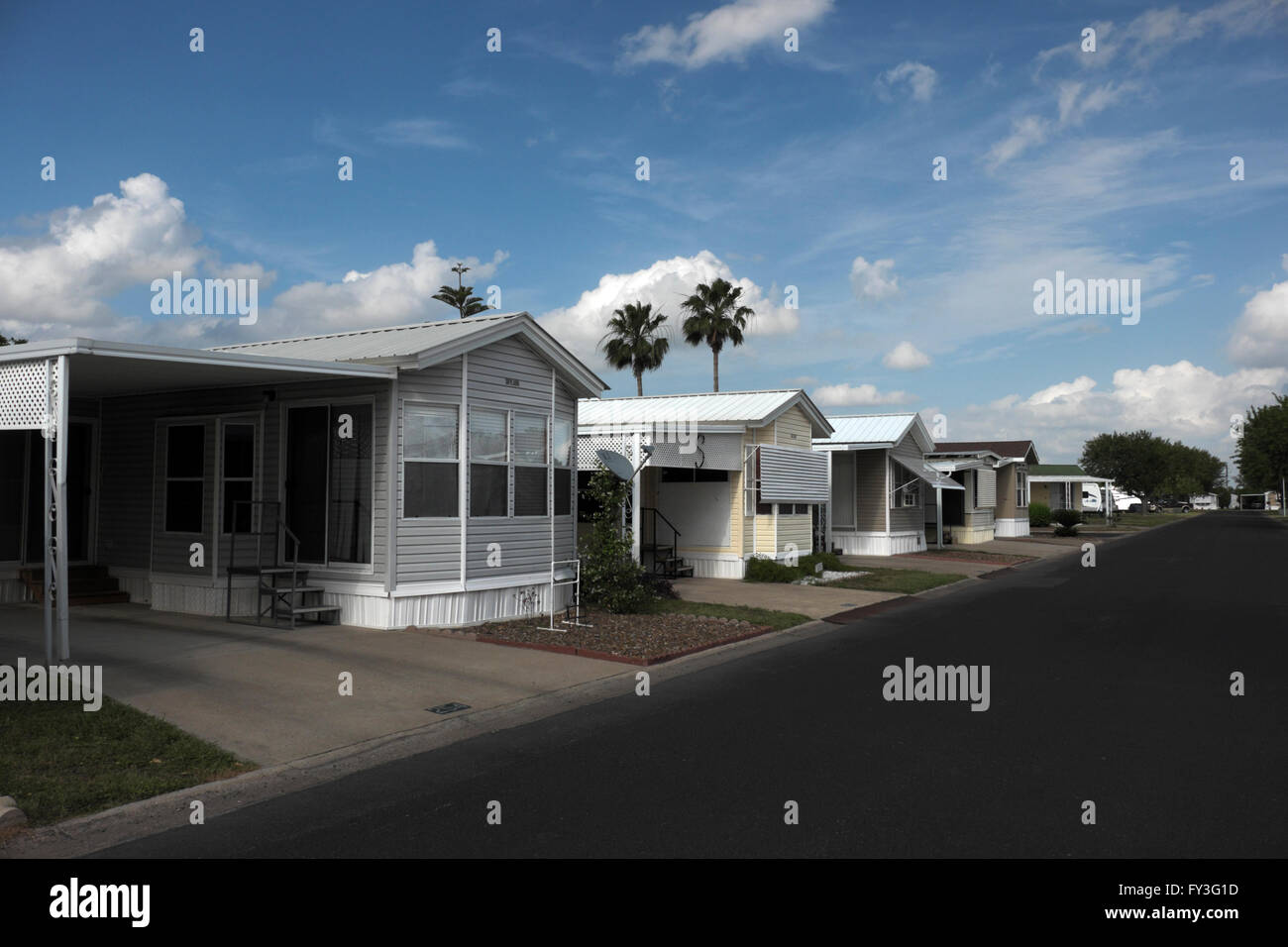 Travel trailers, fifth wheels, mobile homes and park models sit serenely in a trailer park (RV Resort, Mobile home - Stock Image