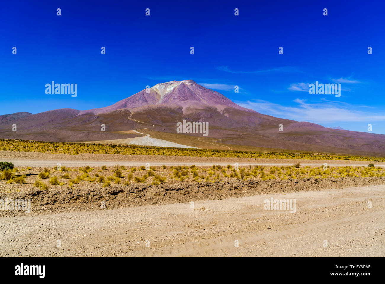 View of crater of domant volcano and glacier at Uyuni in Bolivia - Stock Image