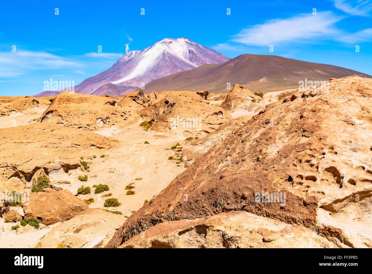 Active volcano with the smoke in Uyuni Bolivia - Stock Image