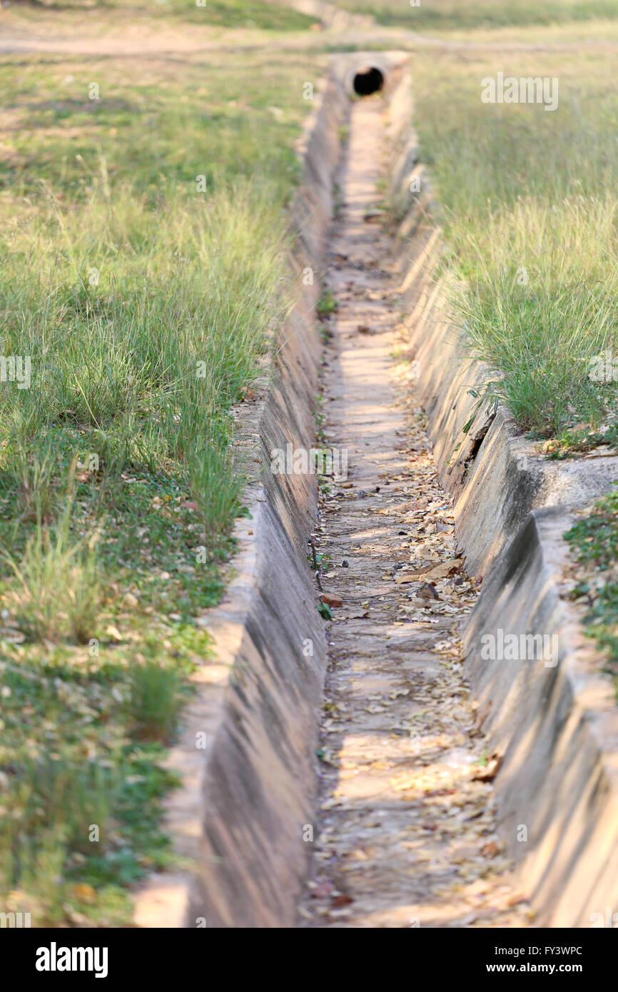 drain in the summer, no water flows through. Stock Photo