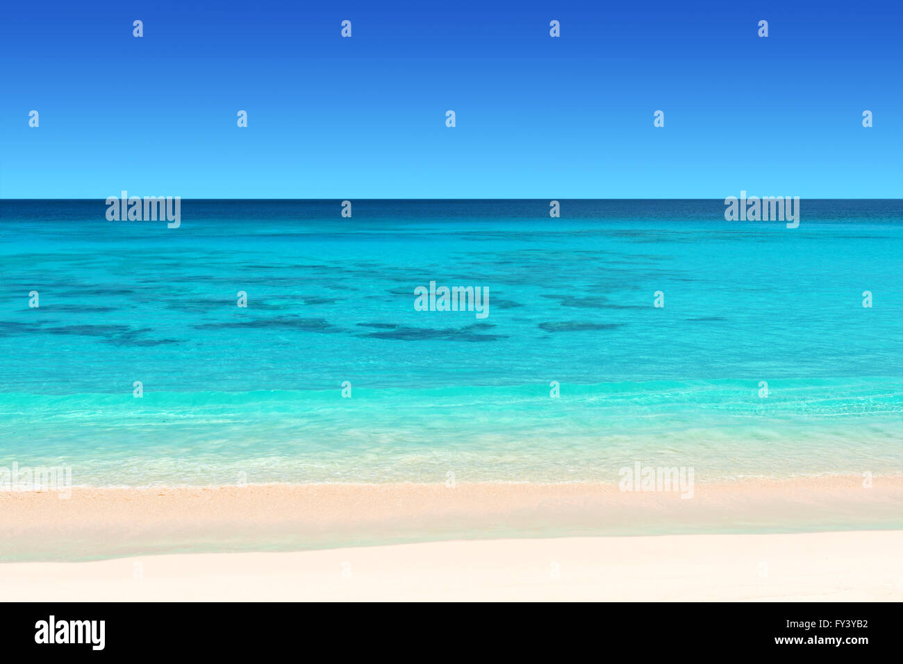 seychelles tropical beach with white sand turquoise water and blue  sky - Stock Image